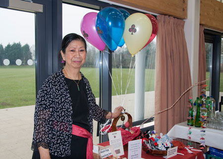 Hao with cancer research display