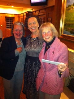 Lady Captain Liz & Kay collect a prize from President Marian