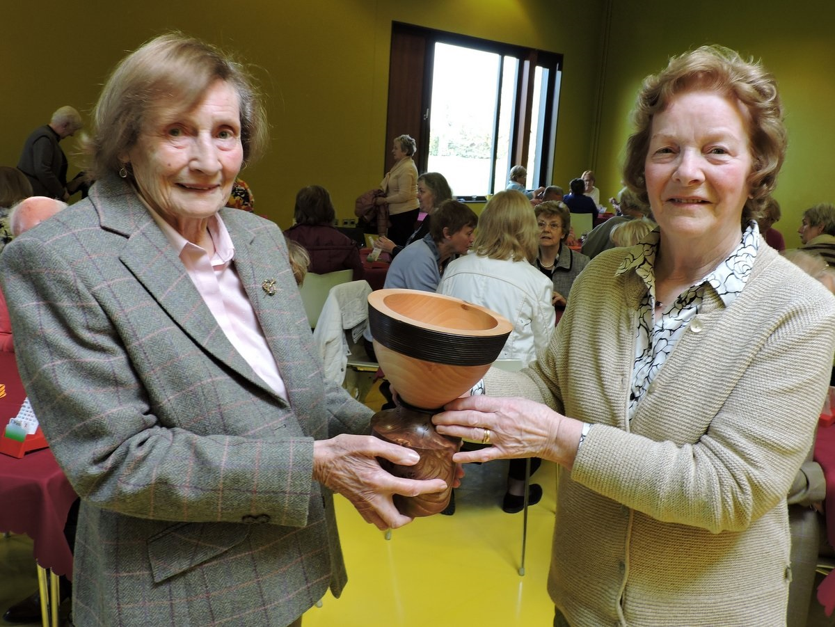 Club member Patty Holland presents the Joyce O'Shaughnessy Memorial Cup to Gretta Dolan winner of the trophy