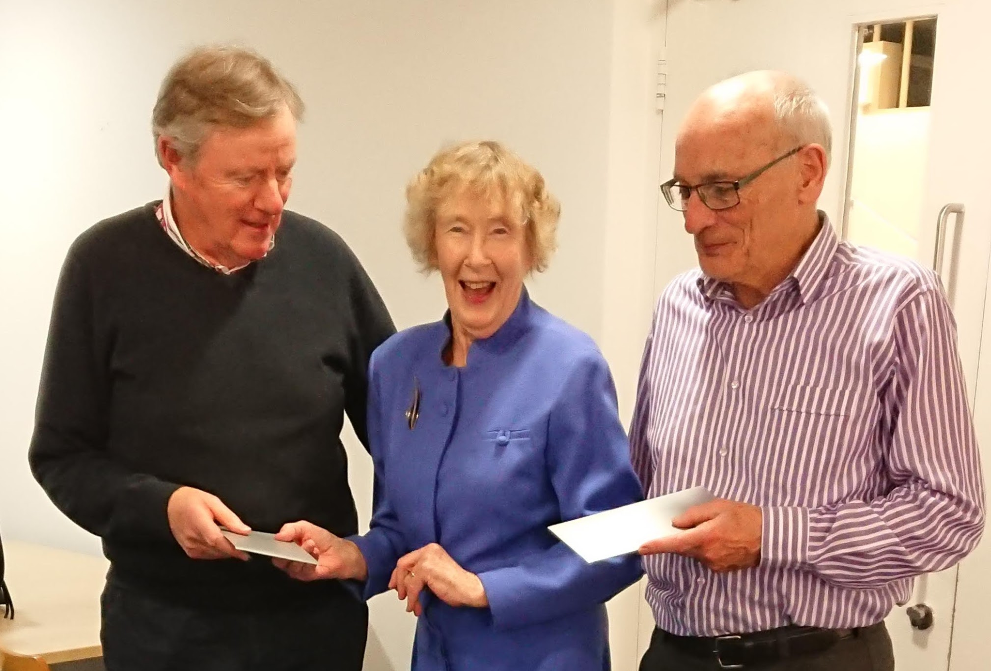 President Máirín Corbett presenting her prize to Chris Fitzgerald and Peter Lynch