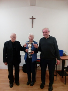 Phil Dennis, Vice President, presents the Mgt. Kelly Cup to John Fitzgibbon and Jim McCormack