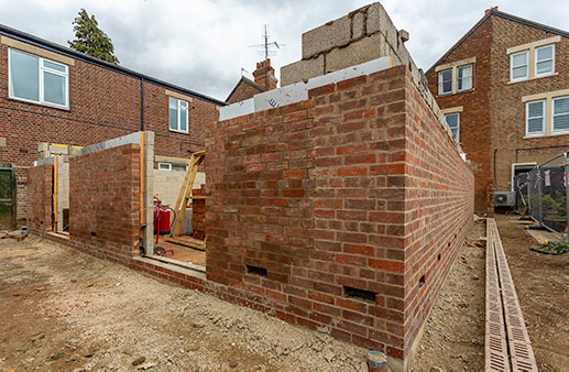 Extension walls nearing completion - 15 August
